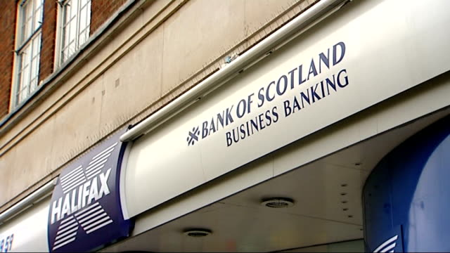 stockvideo's en b-roll-footage met concerns over lloydstsb hbos merger / nationalistation speculation london ext lloyds tsb sign halifax bank of scotland sign above branch lloyds tsb... - channel 4 news