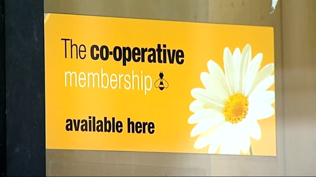 co-op group chairman resigns amid scandal over former chairman paul flowers; sign in window reading 'the co-operative membership available here' - banking sign stock videos & royalty-free footage