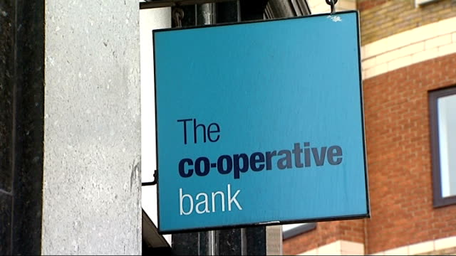 co-operative bank gvs; england: london: angel islington: ext general views of branch of 'the co-operative bank' including 'co-op' sign/ woman using... - banking sign stock videos & royalty-free footage
