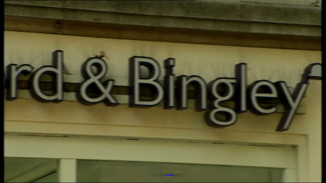 bradford and bingley close to collapse; england: london: ext general views of brandford and bingley branch and sign vox pops - banking sign stock videos & royalty-free footage