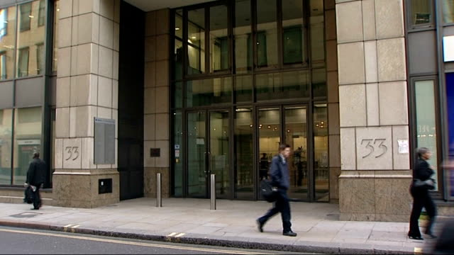 hbos building people along street past entrance to hbos building / entrance to building / sign on wall - banking sign stock videos & royalty-free footage