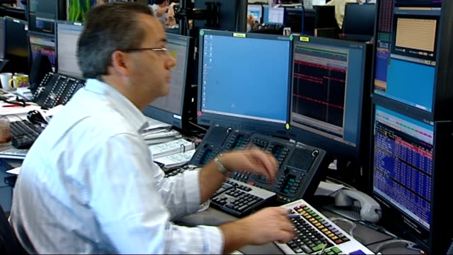 Lloyds TSB HBOS possible merger BGC trading floor ENGLAND London INT Traders sitting at desks with banks of computers on trading floor of City firm...