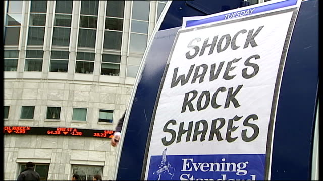 lloyds tsb - hbos possible merger; t16090803 evening standard newspaper stand with headline 'shock waves rock shares' digital sign on reuters office... - banking sign stock videos & royalty-free footage