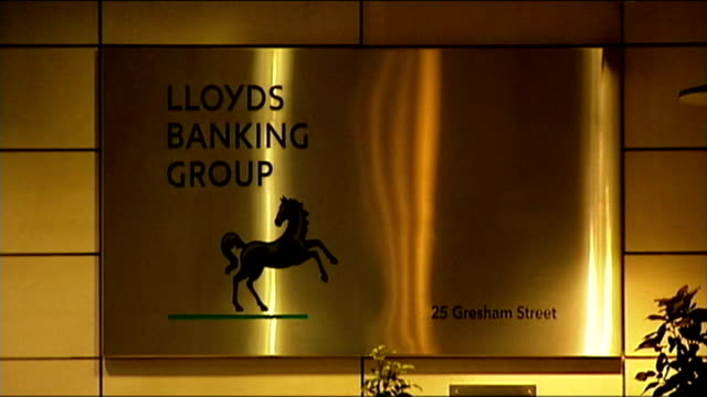 ed miliband speech on banking reform; ext 'rbs' bank sign 'lloyds banking group' sign in lloyds headquarters entrance lobby low angle shot of... - banking sign stock videos & royalty-free footage