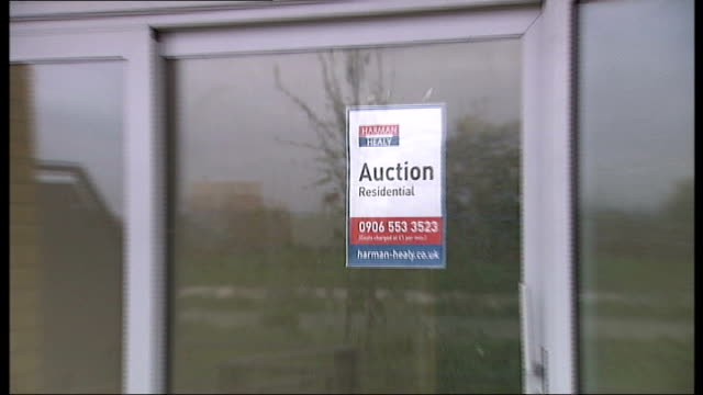 fsa introduces new mortgage rules tx london thamesmead 'auction' poster in window of empty flat/apartment general view newly built apartment block - home ownership stock videos & royalty-free footage