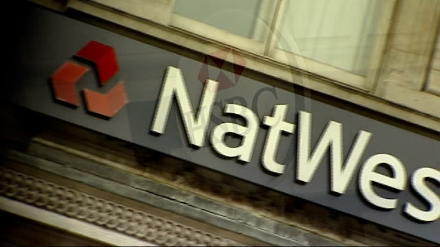 government to sell off northern rock bank graphicised sequence hsbc sign / natwest sign / rbs sign / lloyds tsb sign people taking money from cash... - banking sign stock videos & royalty-free footage