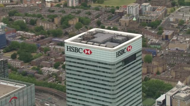 announces uk job losses; england: london: canary wharf: ext air view canary wharf skyscrapers including one canada square and hsbc headquarters... - banking sign stock videos & royalty-free footage