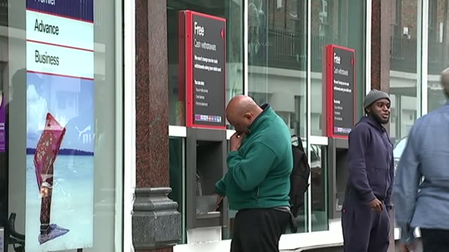 announces uk job losses; london: people and traffic along hsbc bank branch man using atm anonymous man using atm signs 'hsbc' outside branch people... - banking sign stock videos & royalty-free footage