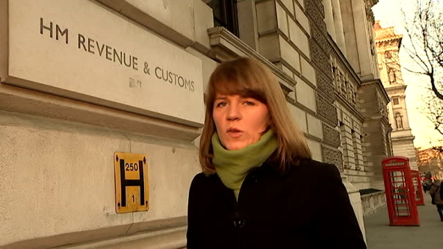 tax evasion row; london: various of 'hm revenue & customs' sign reporter to camera low angle view entrance to hmrc tilt down entrance - banking sign stock videos & royalty-free footage
