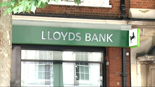 lloyds bank branch; england: london: ext general views of lloyds bank branch / 'lloyds bank' sign / lloyds bank black horse logo / atm / 'welcome to... - banking sign stock videos & royalty-free footage