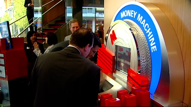 metro bank launch in london int various shots of customers talking to bank employees or workers customers at money machine sign 'no stupid bank... - banking sign stock videos & royalty-free footage