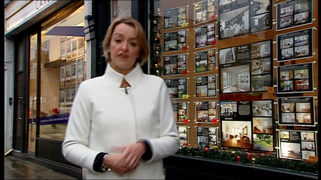 mortgage rules to be tightened ext reporter to camera peta mcsharry set up massaging unidentified woman and interview sot - laura kuenssberg stock-videos und b-roll-filmmaterial