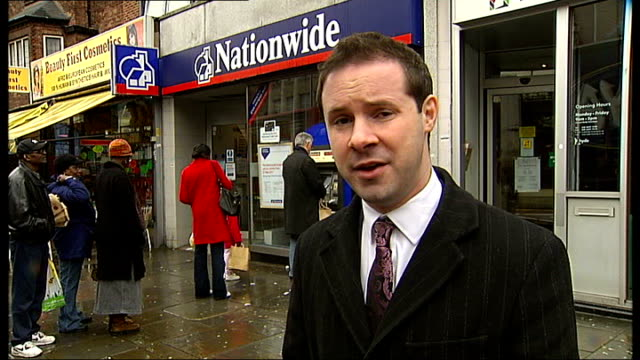 nationwide to close seven branches in south-east london; lewisham: ext reporter to camera close shot of sign reading 'this nationwide branch will be... - banking sign stock videos & royalty-free footage