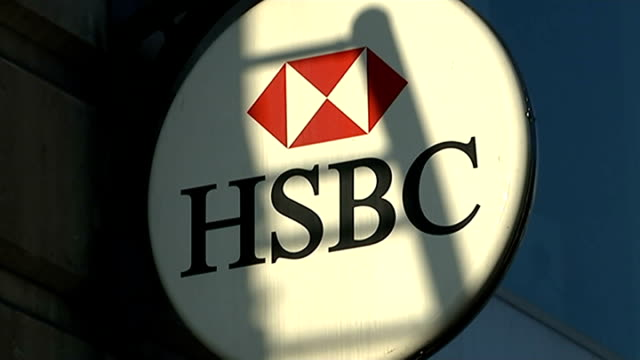 questions raised about hsbc tax evasion scandal; london: close shot sign 'hm revenue & customs' close shot sign 'hsbc' pull focus reporter to camera - banking sign stock videos & royalty-free footage