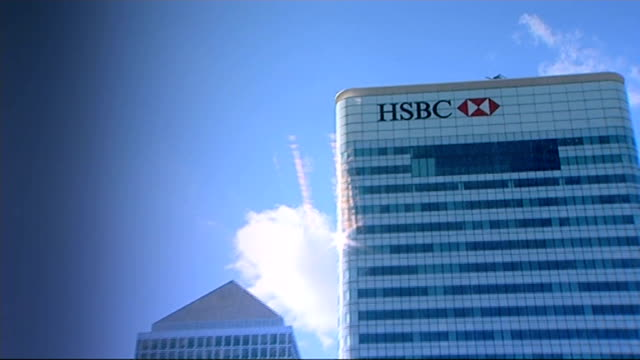 questions raised about hsbc tax evasion scandal; t022030911 / tx 2.3.2009 england: london: canary wharf: ext hsbc headquarters building with blue sky... - banking sign stock videos & royalty-free footage