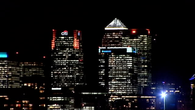 rate fixing scandal serious fraud office launch criminal investigation england london canary wharf barclays headquarters building at night canary... - banking sign stock videos & royalty-free footage