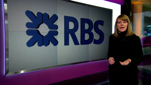 RBS admits misleading MPs over Global Restructuring Group unit GIR INT Reporter to camera with video wall