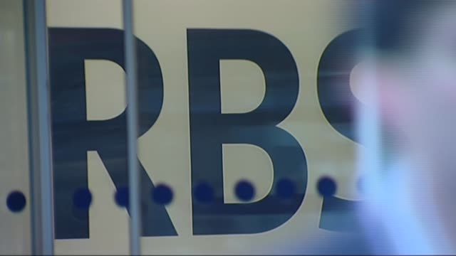 reports losses of more than 2 billion pounds; t19010933 / tx 19.1.2009 close shot rbs sign in entrace foyer of rbs headquarters glass doors closing... - banking sign stock videos & royalty-free footage