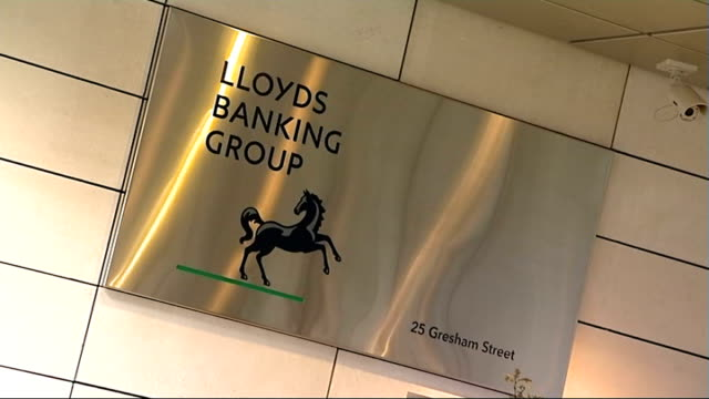 report recommends reforms to uk banking industry; banking: report recommends reforms to uk banking industry; ext 'lloyds banking group' sign on wall... - banking sign stock videos & royalty-free footage
