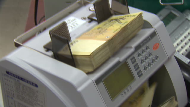 Banknote counter counting Fifty Thousand Won (South Korean Currency)