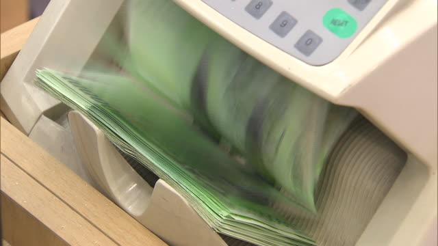 Banknote counter counting Ten Thousand Won (South Korean Currency)