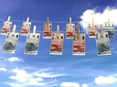banknotes hanging in a clothes line. - clothes peg stock videos & royalty-free footage