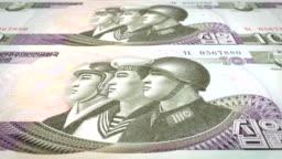 Banknotes of ten wons of North Korea rolling, cash money, loop