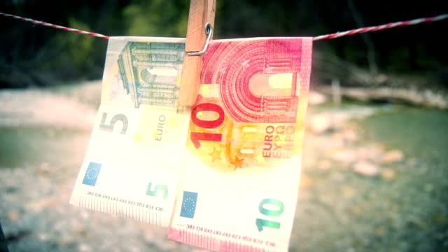 banknotes on clothesline - laundry stock videos & royalty-free footage
