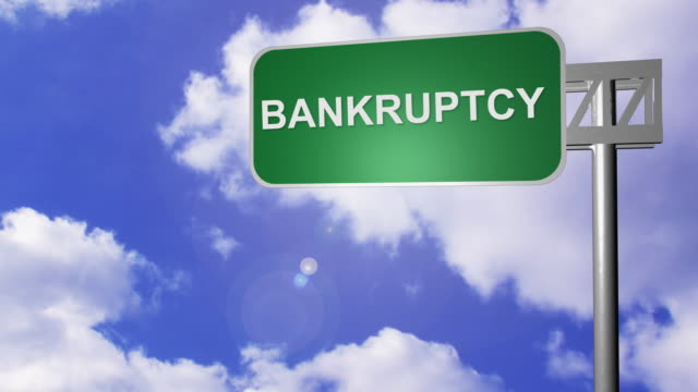ws t/l bankruptcy way on signpost with moving clouds in background / cape town, south africa - lettera maiuscola video stock e b–roll