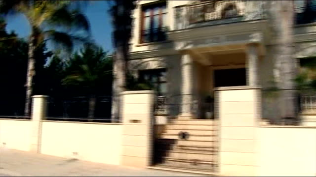 banks stay closed while bailout deal is sought cyprus nicosia shot from car past large houses / villas general view of 'pycbmapket' building and sign - キプロス ニコシア点の映像素材/bロール