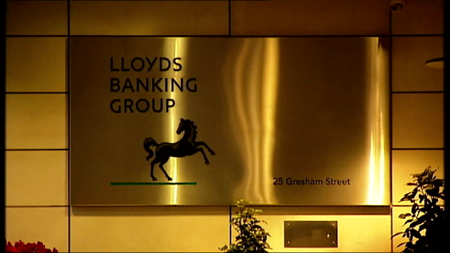 banks under fire over bonus payments; t13020907 england: london: ext sign 'lloyds banking group' at headquarters building wipe to... - banking sign stock videos & royalty-free footage