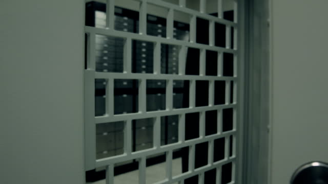 Bank.Security opening the door leading into room with deposit boxes