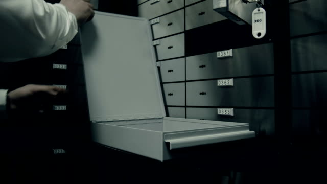 bank.security opening the door leading into room with deposit boxes - locker stock videos and b-roll footage