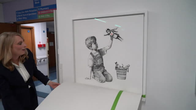 banksy artwork called game changer to recognise the work of the nhs during the coronavirus crisis unveiled at southampton general hospital - バンクシー点の映像素材/bロール