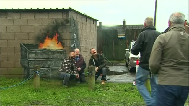 Banksy mural on Port Talbot steelworker's garage to be transported to new art museum in town centre WALES Port Talbot EXT Various shots of Banksy...