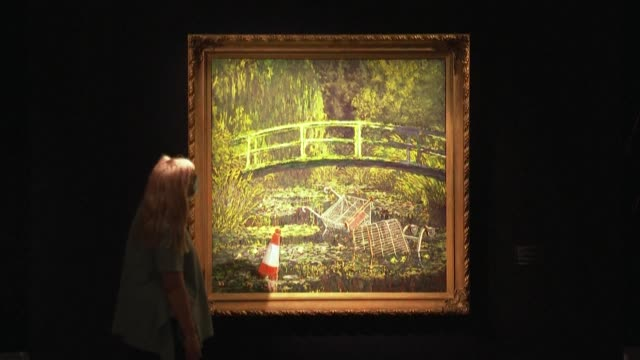 banksy 'show me the monet' an oil on canvas transforming claude monet's famous 'water lilies pond' into a modernera flytipping spot is exhibited at... - canvas stock videos & royalty-free footage