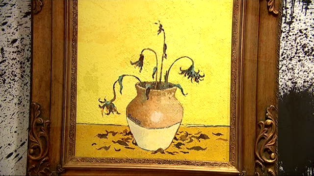 Banksy works exhibited at Sotheby's ENGLAND London Sotheby's INT Close shot Banksy painting 'UFO Invasion' Close shot Banksy painting 'Sunflowers...
