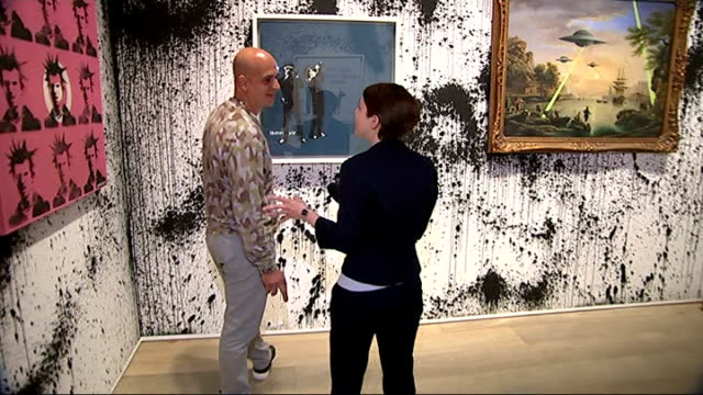 banksy works exhibited at sotheby's lazarides sot various of lazarides talking to reporter in exhibition room banksy paintings of kate moss on... - sotheby's stock videos and b-roll footage
