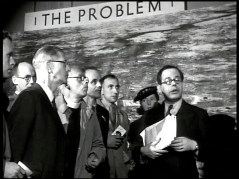 banner 'exhibition county of london plan.' men talking at 'the problem' display. display 'westminster precinct.' city model. service men & women... - rebuilding stock videos & royalty-free footage
