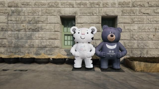 A banner featuring the 2018 PyeongChang Winter Olympic Games mascot Soohorang left and Bandabi right hangs displayed outside the City Hall in Seoul...
