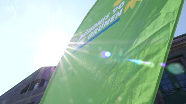 a banner from the green party can be seen in front of the venue delegates enter the event venue a banner from the green p arty can be seen as well a... - green party stock videos and b-roll footage