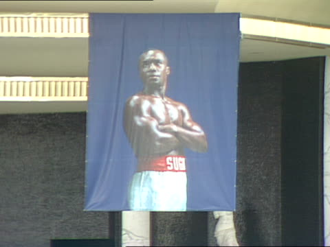 a banner of sugar ray leonard advertising his fight with don lalonde in november 1988 hangs in the entrance to caesars palace in las vegas - casino poster stock videos & royalty-free footage