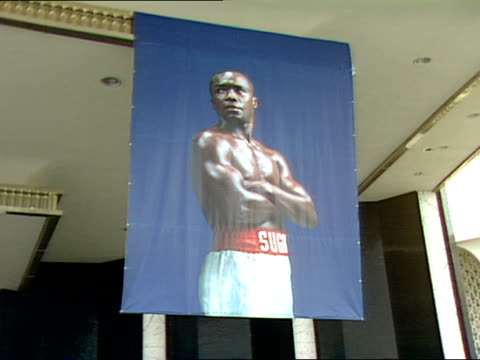 a banner of sugar ray leonard hangs in front of caesars palace advertising his championship fight with don lalonde on november 7 1988 - casino poster stock videos & royalty-free footage