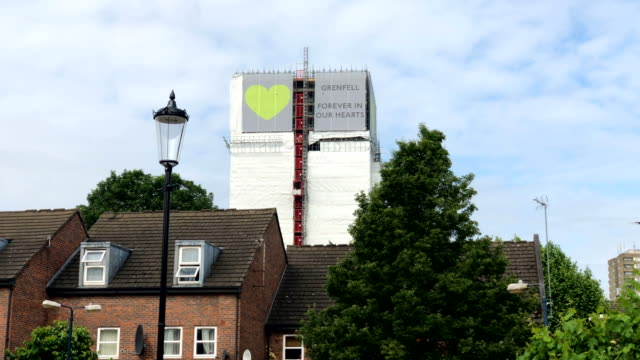 a banner of support featuring green hearts sits on top of the outside of grenfell tower on june 8 2018 in london england june 14 2018 marks the first... - conceptual symbol stock videos and b-roll footage