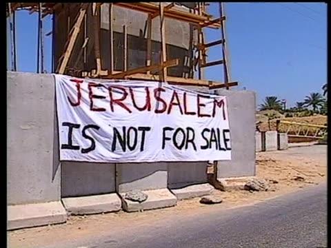 banner on building site 'jerusalem is not for sale' gaza july 1994 - gaza strip stock videos & royalty-free footage