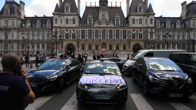 banner on which we can read discriminated vtc as people gather in front of city hall at the call of several vtc organizations against the decision of... - chauffeur stock videos & royalty-free footage