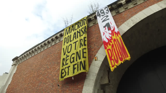 banner reading macron polanski your reign is over during demonstration on march 8 women's day paris france - kampf der geschlechter konzept stock-videos und b-roll-filmmaterial