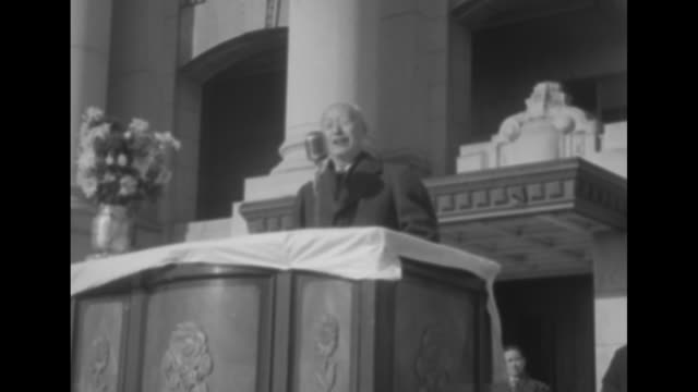 """banner stretched across front of building saying """"welcome meeting for cardinal spellman"""" / three shots of crowd of south koreans gathered in front of... - vangen bildbanksvideor och videomaterial från bakom kulisserna"""