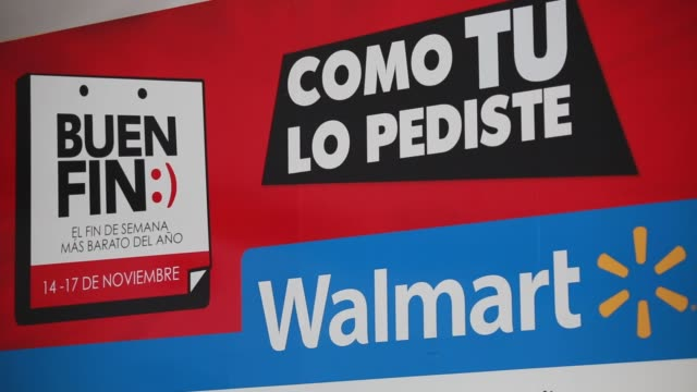 vídeos de stock, filmes e b-roll de a banner with the signages of walmart group stores advertising the good sales weekend el buen fin alvaro arrigunaga senior vice president... - méxico central