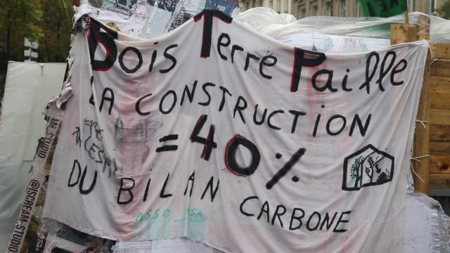 wood earth straw construction = 40% of the carbon footprint the activists of the ecologist movement extinction rebellion have paralyzed the place du... - carbon footprint stock videos and b-roll footage